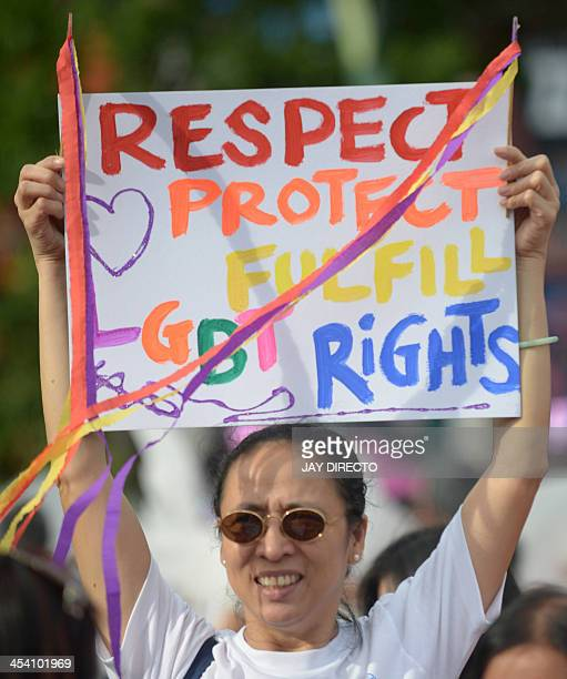 Supporters take part in an annual gay pride march calling for equal rights for lesbian gay bisexual and transgender people in Manila on December 7...