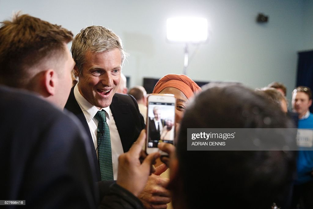 Supporters take pictures with Conservative Party London Mayoral candidate Zac Goldsmith (2L) at a campaign event in Richmond, southwest London, on May 3, 2016. Londoners will vote for a new London Mayor on May 5. / AFP / ADRIAN