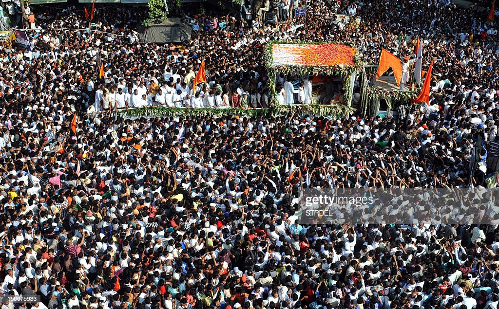 Supporters throng the funeral cortege of Indian Hindu nationalist Shiv Sena party leader Bal Thackeray during a procession in Mumbai on November 18, 2012. Huge crowds gathered in Mumbai to witness the funeral procession of Bal Thackeray, chief of the Hindu nationalist Shiv Sena party and one of India's most divisive politicians. Thackeray, who called his followers 'Hindu warriors' and was widely accused of stoking ethnic and religious violence, died aged 86, triggering a virtual shutdown of the city.