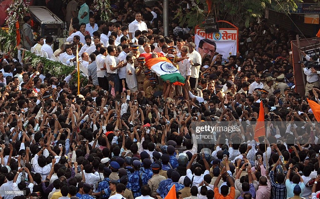 Supporters throng the funeral cortege of Indian Hindu nationalist Shiv Sena party leader Bal Thackeray during a procession in Mumbai on November 18, 2012. Huge crowds gathered in Mumbai to witness the funeral procession of Bal Thackeray, chief of the Hindu nationalist Shiv Sena party and one of India's most divisive politicians. Thackeray, who called his followers 'Hindu warriors' and was widely accused of stoking ethnic and religious violence, died aged 86, triggering a virtual shutdown of the city. AFP PHOTO/STR