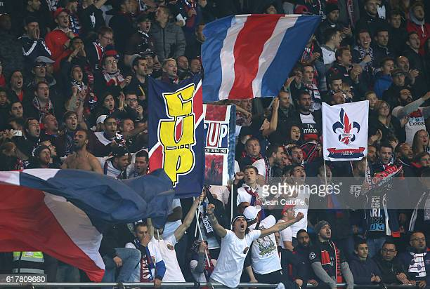 Supporters ultras of PSG cheer for their team during the French Ligue 1 match between Paris SaintGermain PSG and Olympique de Marseille at Parc des...