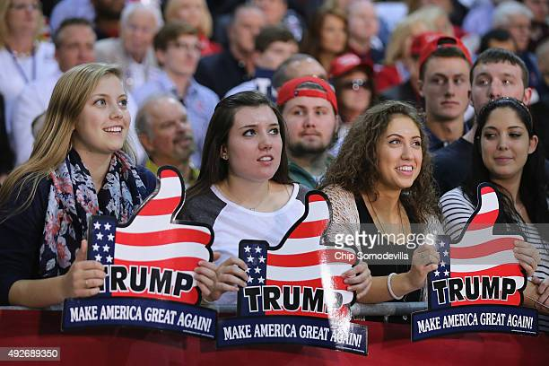 Supporters wait for presidential candidate and Republican frontrunner Donald Trump at a campaign rally at the Richmond International Raceway October...