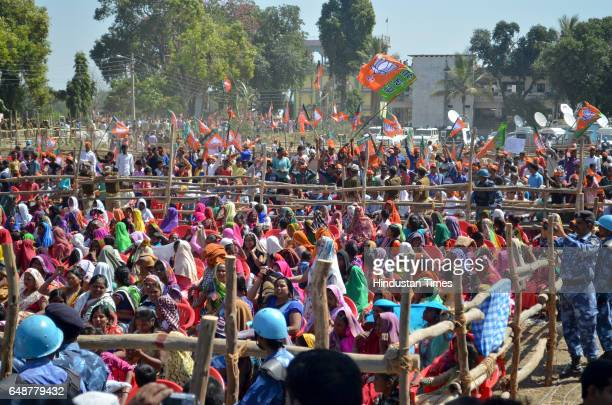 Supporters wait for Prime Minister Narendra Modi during rally at Math Gadwaghat Ashram on March 6 2017 in Varanasi India For the last three days PM...