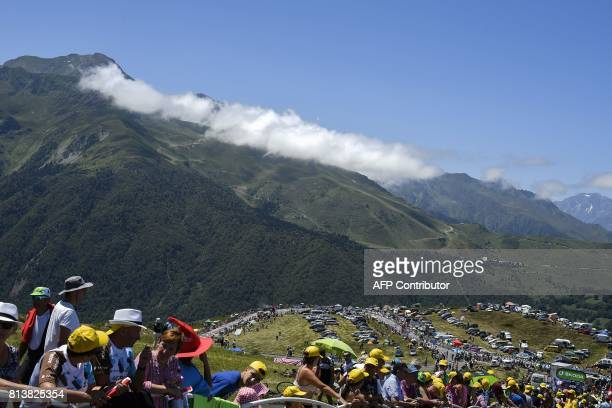 Supporters wait for riders along the road near the finish line during the 2145 km twelfth stage of the 104th edition of the Tour de France cycling...