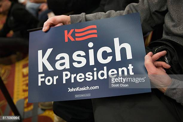 Supporters wait for the arrival of Republican presidential candidate Ohio Gov John Kasich at a campaign rally at the Crowne Plaza Milwaukee West...