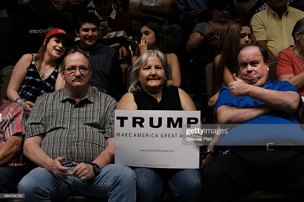 Supporters wait for the presumtive Republican presidential candidate Donald Trump to speak at a rally in Fresno on May 27, 2016 in Fresno, California. Trump is on a Western campaign trip which saw stops in North Dakota and Montana yesterday and two more in California today.