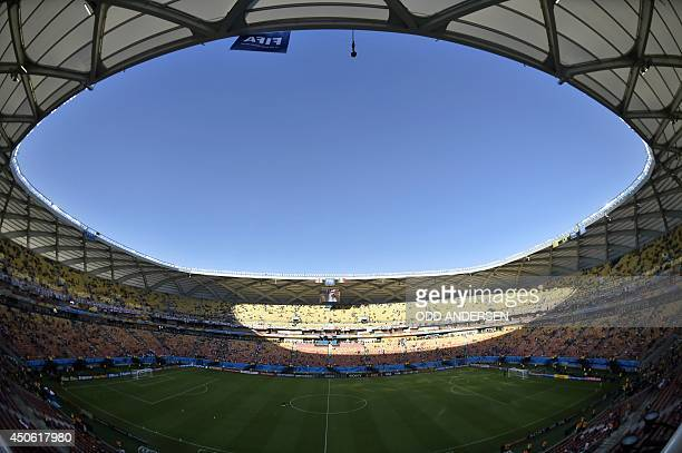 Supporters wait for the start of a Group D football match between England and Italy at the Amazonia Arena in Manaus during the 2014 FIFA World Cup on...