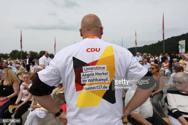 Supporters wait for the start of an election campaign rally with Angela Merkel Germany's chancellor and Christian Democratic Union leader not...
