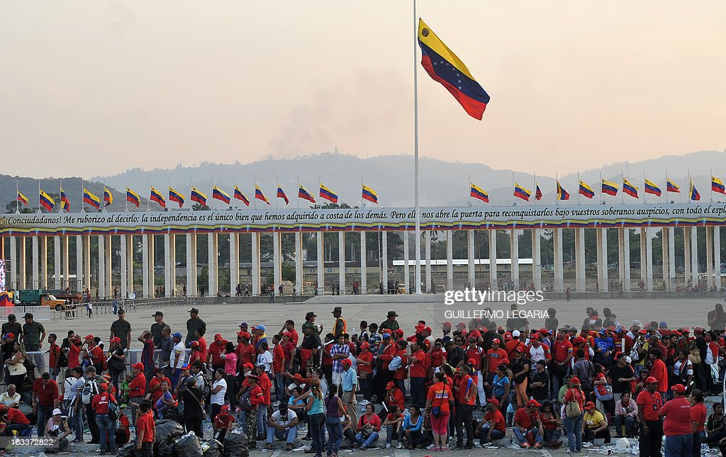 Supporters wait in line to pay their last respects to late Venezuelan President Hugo Chavez, outside the Military Academy in Caracas on March 8, 2013. Venezuela gave Hugo Chavez a lavish farewell on Friday at a state funeral that brought some of the world's most notorious strongmen to tears, with music, prayers and a fiery speech by his successor. AFP PHOTO/Guillermo Legaria