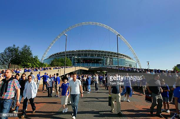 Supporters walk to the Underground station after the FA Cup sponsored by EON Final match between Chelsea and Everton at Wembley Stadium on May 30...