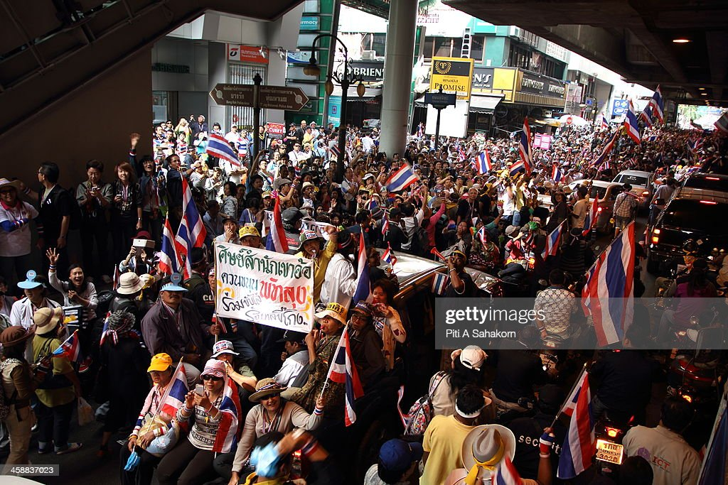 Supporters watch and cheer as Thai anti-government protesters march through the streets of Bangkok. More than one million anti-government protesters massed ahead of a major rally aimed at toppling the Prime Minister, paralysing parts of central Bangkok. The Election Commission (EC) has expressed concern over the mass anti-government rallies beginning today, fearing they could prevent the first day of election candidate registration on Monday. The Democrat Party said it would boycott February's general election, deepening a political crisis as protesters called for another major rally to step up efforts to oust the government and force political reforms.