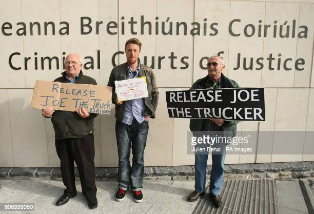 Supporters watch as Joe McNamara originally from Achill Island Co Mayo leaves Dublin District Court after he was charged with one count of criminal...
