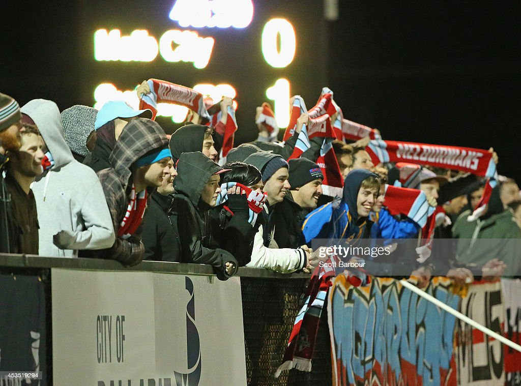 Supporters watch from the crowd during the FFA Cup match between Melbourne City and Sydney FC at Morshead Park Stadium on August 12, 2014 in Ballarat, Australia.