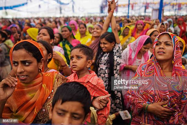Supporters watch the arrival of Mayawati Kumari of the Bahujan Samaj Party and Chief Minister of Uttar Pradesh state during a political rally on...