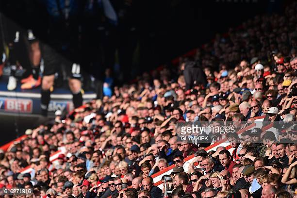 Supporters watch the game in the sunshine during the English Premier League football match between Bournemouth and Tottenham Hotspur at the Vitality...