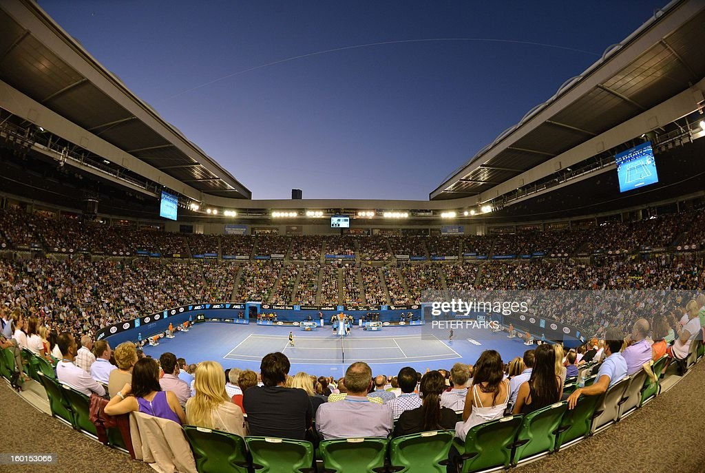 Supporters watch the the men's singles final between Serbia's Novak Djokovic and Britain's Andy Murray on day 14 of the Australian Open tennis tournament in Melbourne on January 27, 2013. AFP PHOTO / PETER PARKS IMAGE STRICTLY RESTRICTED TO EDITORIAL USE - STRICTLY NO COMMERCIAL USE