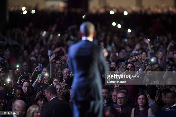 Supporters wave at US President Barack Obama after his farewell speech at McCormick Place on January 10 2017 in Chicago Illinois Obama addressed the...