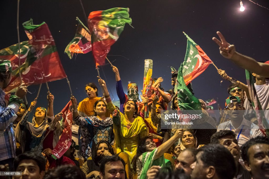Supporters wave flags and cheer prior to the arrival of Imran Khan, chairman of the Pakistan Tehrik e Insaf (PTI) party, during an election campaign rally on May 06, 2013 in Multan, Pakistan. Pakistan's parliamentary elections are due to be held on May 11. Imran Khan of Pakistan Tehrik e Insaf (PTI) and Nawaz Sharif of the Pakistan Muslim League-N (PMLN) have been campaigning hard in the last weeks before polling.