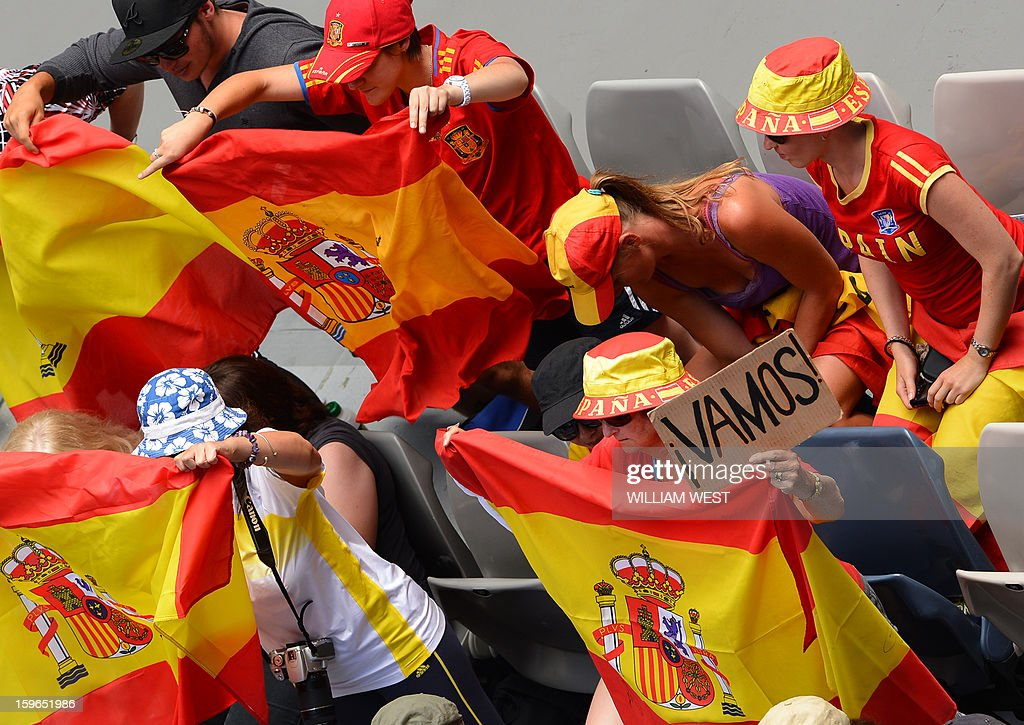 Supporters wave flags as they cheer for Spain's Fernando Verdasco during his men's singles match against South Africa's Kevin Anderson on the fifth day of the Australian Open tennis tournament in Melbourne on January 18, 2013. AFP PHOTO/WILLIAM WEST IMAGE STRICTLY RESTRICTED TO EDITORIAL USE - STRICTLY NO COMMERCIAL USE