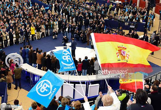Supporters wave flags of the PP during a meeting of Spanish Prime Minister and Popular Party leader and candidate in the December 20 general...