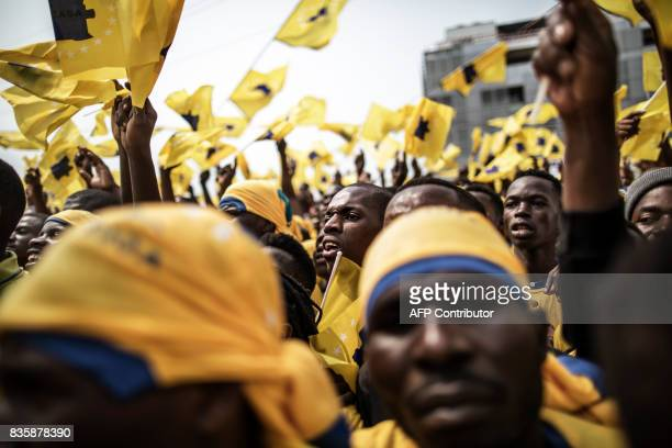 Supporters wave flags prior to the speech of the leader of the Angolan opposition party CASACE Abel Chivukuvuku during a rally in Luanda on August 20...