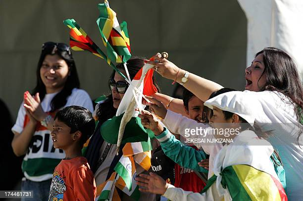 Supporters wave Indian and Zimbabwean flags during the second oneday international ODI series between hosts Zimbabwe and India at Harare Sports Club...