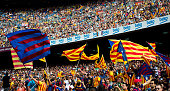Supporters wave proindependence of Catalonia flags during the La Liga match between FC Barcelona and UD Las Palmas at Camp Nou on September 26 2015...