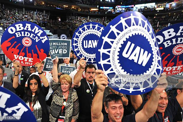 Supporters wave signs during President of the International Union United Automobile Aerospace and Agricultural Implement Workers of America Bob King...