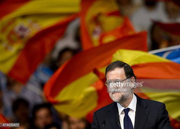 Supporters wave Spanish flags as Prime Minister Mariano Rajoy takes part in Popular Party 's closing campaign meeting in Madrid on May 22 2015 ahead...
