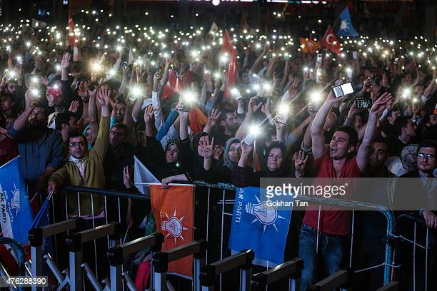 Supporters wave Turkish flags and shout slogans outside the AK Party headquarters June 7 2015 in Ankara TurkeyPartial results from Turkey's...