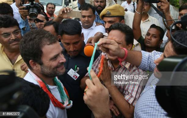 Supporters welcome Congress VicePresident Rahul Gandhi during his visit to the house of close family friends Mr and Mrs Katju on July 19 2017 in...