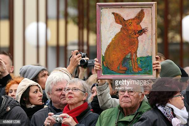 Supporters welcome German Chancellor Angela Merkel to the Chapel of Reconciliation behind a section of the former Berlin Wall during celebrations for...