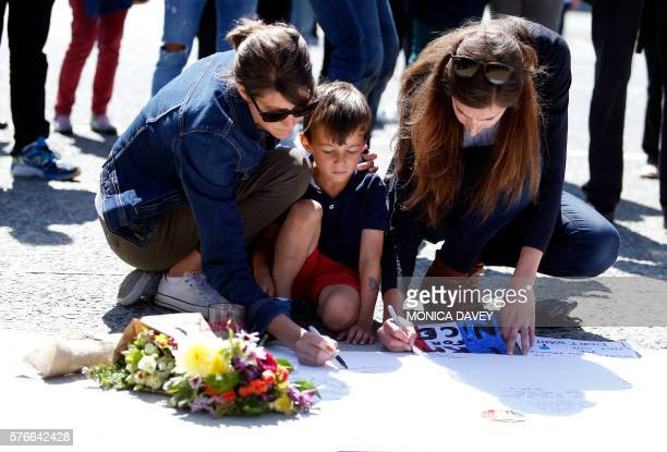 TOPSHOT Supporters write notes to victims of the attack in Nice France during a vigil and moment of silence in San Francisco California 16 July 2016...