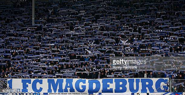 Supportersl of Magdeburg cheer during the Third League match between 1 FC Magdeburg and VfR Aalen at MDCCArena on December 10 2016 in Magdeburg...