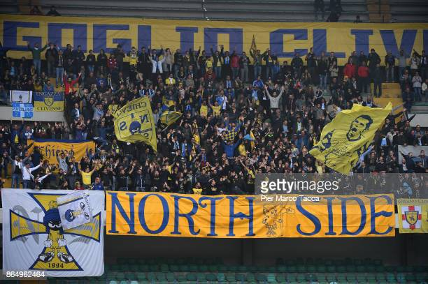Supportes of AC CHievo Verona waves the flags during the Serie A match between AC Chievo Verona and Hellas Verona FC at Stadio Marc'Antonio Bentegodi...