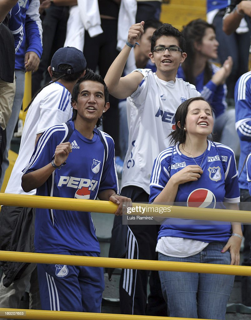 "Supportes of Millonarios cheer their team during the match between Independiente Santa Fe and Millonarios as part of the the Champions Super League at Nemesio Camacho ""El Campin"" stadium on January 27, 2013 in Bogota, Colombia."