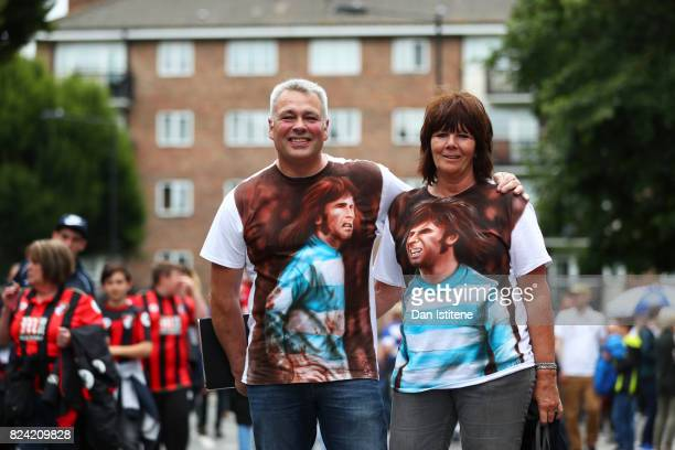 QPR supportes pose wearing tshirts in tribute to former player Stan Bowles ahead of his benefit match and the preseason friendly between Queens Park...