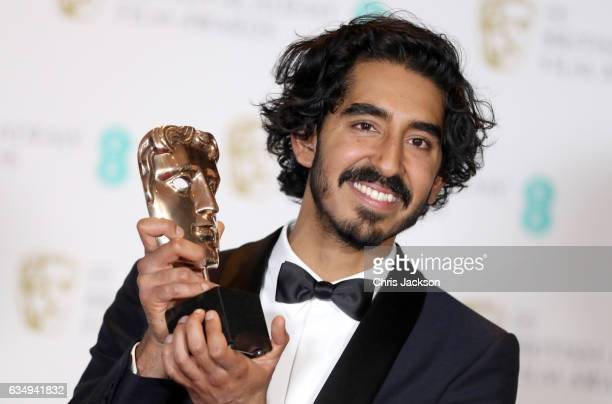 Supporting Actor winner Dev Patel poses with his award in the winners room during the 70th EE British Academy Film Awards at Royal Albert Hall on...