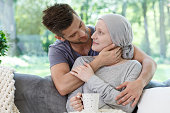 Sick girlfriend in headscarf after radiotherapy supported by loving boyfriend