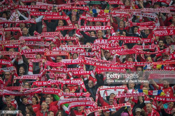 Supports of FSV Mainz 05 singing 'you'll never walk alone' prior to the 1 Bundesliga match between 1 FSV Mainz 05 and Borussia Moenchengladbach at...