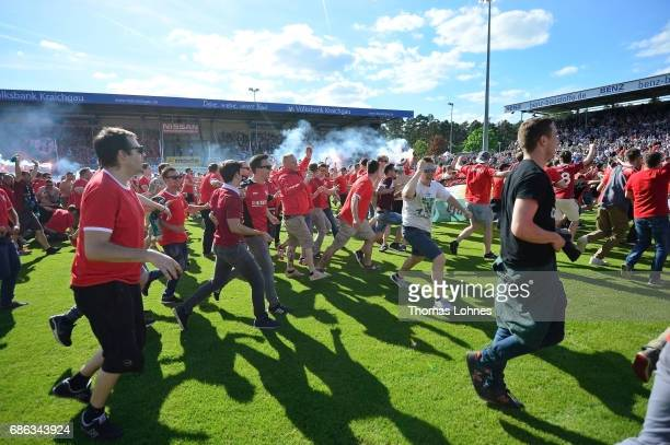 Supports of Hannover 96 celebrate shortly after the Second Bundesliga match between SV Sandhausen and Hannover 96 at Hardtwaldstadion on May 21 2017...