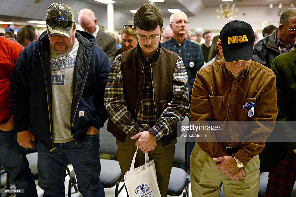 Supports pray during the Delaware State Sportsmen's Association Second Amendment rally at the Modern Maturity Center on January 20, 2013 in Dover, Delaware. U.S. President Barack Obama recently unveiled a package of gun control proposals that include universal background checks and bans on assault weapons and high-capacity magazines.