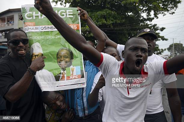 Suppoters celebrate victory of main opposition All Progressives Congress presidential candidate Mohammadu Buhari at Obalende district in Lagos on...