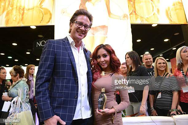 Supre Tan Owner Bruce West and TV Personality Nicole 'Snooki' Polizzi attend the Nicole 'Snooki' Polizzi Meet Greet during the 2013 Smart Tan...