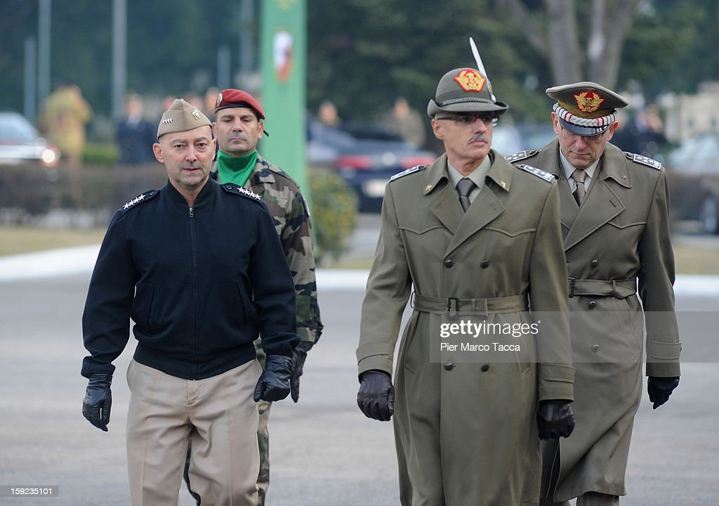 Supreme Allied Commander Europe (SACEUR) Admiral <a gi-track='captionPersonalityLinkClicked' href=/galleries/search?phrase=James+Stavridis&family=editorial&specificpeople=3965989 ng-click='$event.stopPropagation()'>James Stavridis</a> (C) Commander Biagio Abrate (R) General <a gi-track='captionPersonalityLinkClicked' href=/galleries/search?phrase=Claudio+Graziano&family=editorial&specificpeople=853007 ng-click='$event.stopPropagation()'>Claudio Graziano</a>, Chief of the Italian Army during the departure Ceremony for OTAN Rapid Deployable Corps - Italy bound for Afghanistan at Ugo Mara Barracks on January 10, 2013 in Solbiate Olona, Italy. NRDC - ITA is one of the Alliance's seven Rapid Deployable Corps Headquarters, and is one of the two high profile NATO organisations based in Italy