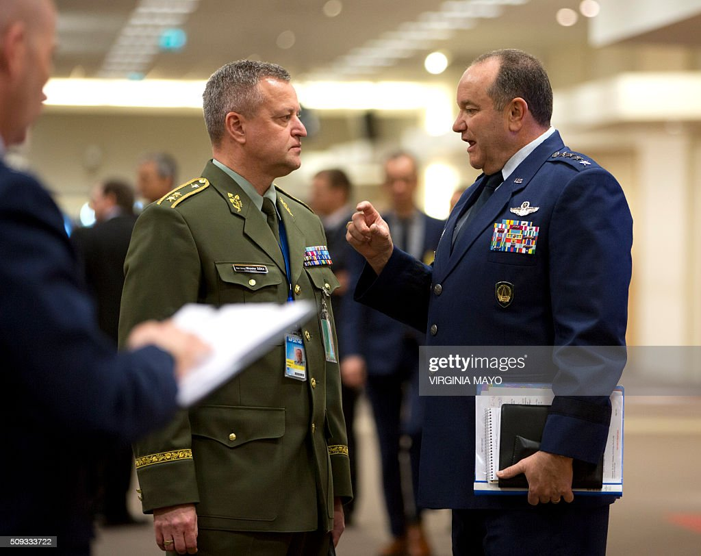 Supreme Allied Commander Europe, Gen. Philip Breedlove (R) speaks with Czech Republic's NATO-EU military representative Maj. Gen. Miroslav Zizka (C) prior to a meeting at NATO headquarters in Brussels on February 10, 2016. NATO defense ministers convene a two-day meeting to discuss current defense issues and whether the Alliance should take a more direct role in dealing with its gravest migrant crisis since WWII. / AFP / POOL / Virginia Mayo