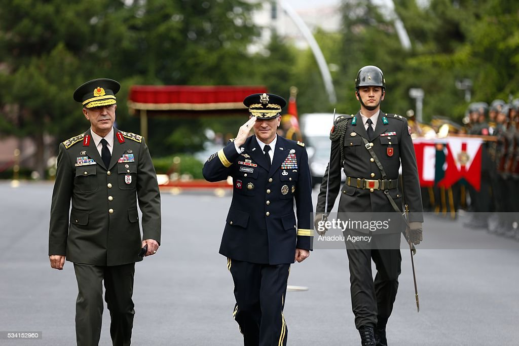 Supreme Allied Commander Europe of NATO Allied Command Operations Curtis M. Scaparrotti (C) salutes the guard of honor with Chief of the General Staff of the Turkish Armed Forces, Hulusi Akar (L) during the official welcoming ceremony in Ankara, Turkey on May 25, 2016.