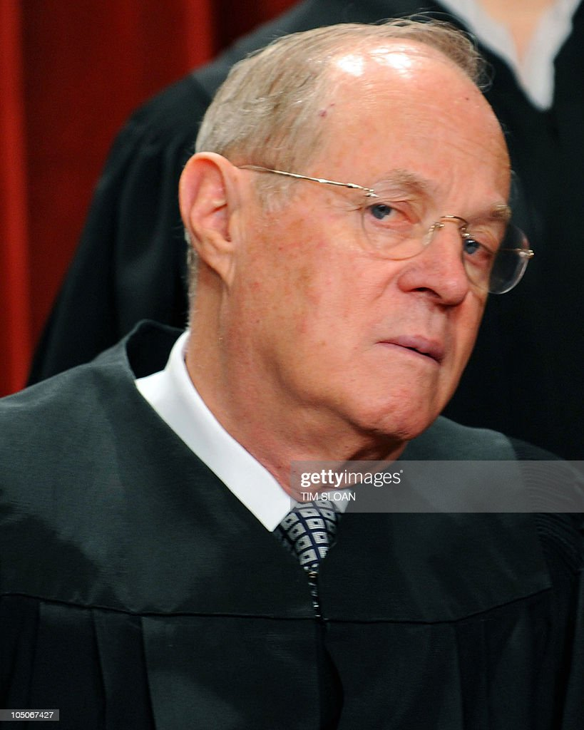 US Supreme Court Associate Justice Anthony M. Kennedy participates in the courts official photo session on October 8, 2010 at the Supreme Court in Washington, DC.