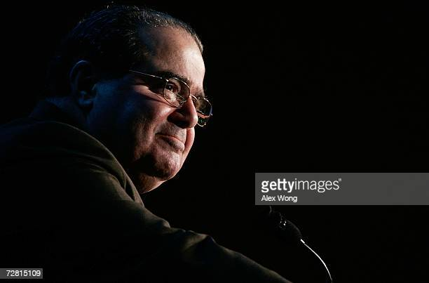 S Supreme Court Associate Justice Antonin Scalia pauses as he addresses a Northern Virginia Technology Council breakfast December 13 2006 in McLean...