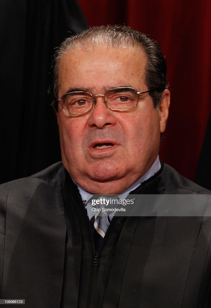 U.S. Supreme Court Associate Justice <a gi-track='captionPersonalityLinkClicked' href=/galleries/search?phrase=Antonin+Scalia&family=editorial&specificpeople=215620 ng-click='$event.stopPropagation()'>Antonin Scalia</a> poses for photographs in the East Conference Room at the Supreme Court building October 8, 2010 in Washington, DC. This is the first time in history that three women are simultaneously serving on the court.